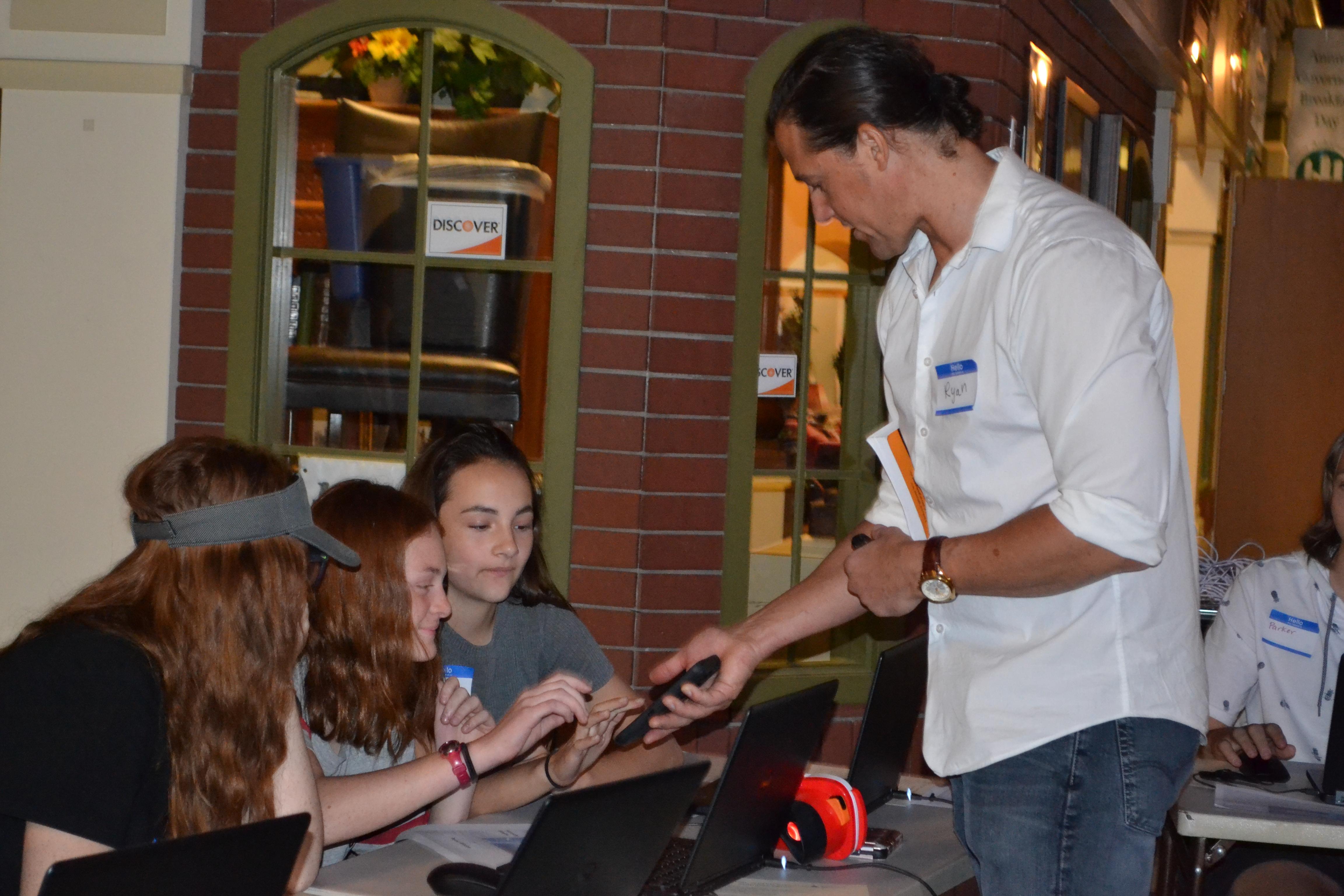 Ryan Buchanan showing students mobile device