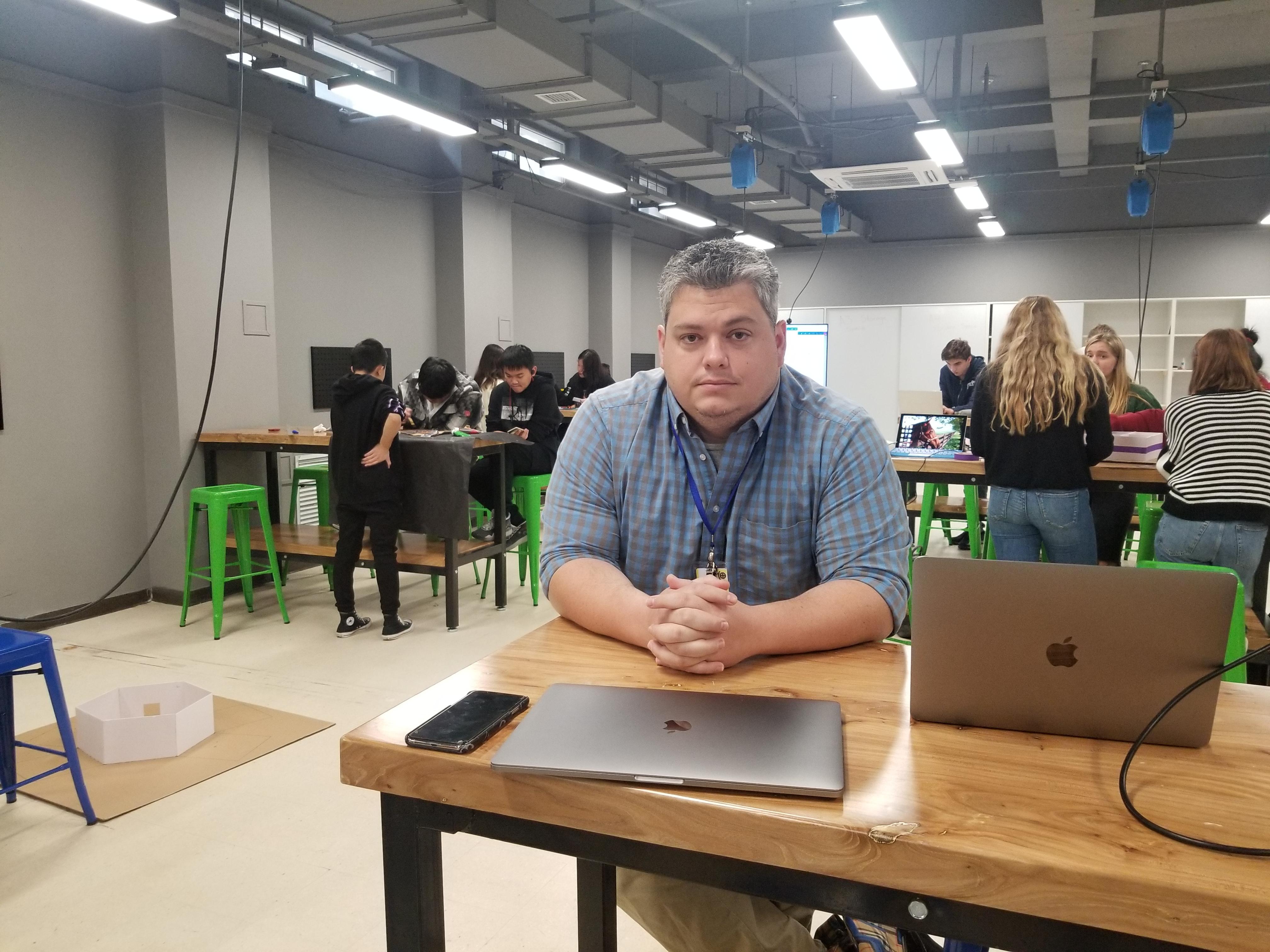 Justin Sheehan sitting in classroom